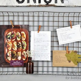 Hang a metal basket, add cothes pins to showcase memos or recipes!