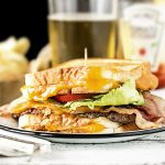 This Grilled Cheese Bacon Burger from livelaughrowe.com looks to be packed with some of my favorites. One flavorful burger coming right up.