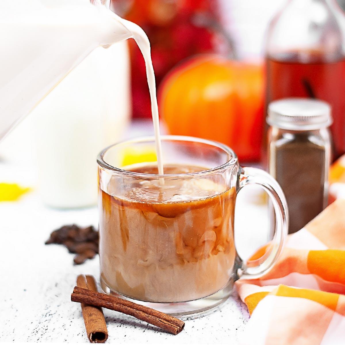 Pouring Sugar-Free Pumpkin Spice Creamer into Coffee