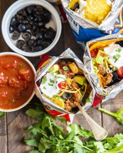 An overhead shot of walking tacos showing the taco toppings inside.