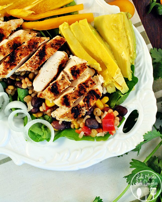 Southwest Chicken Salad with Avocado Dressing - A refreshing and light southwest chicken salad with avocado dressing, using grilled chicken with rice, black beans, tomatoes, avocado and peppers.