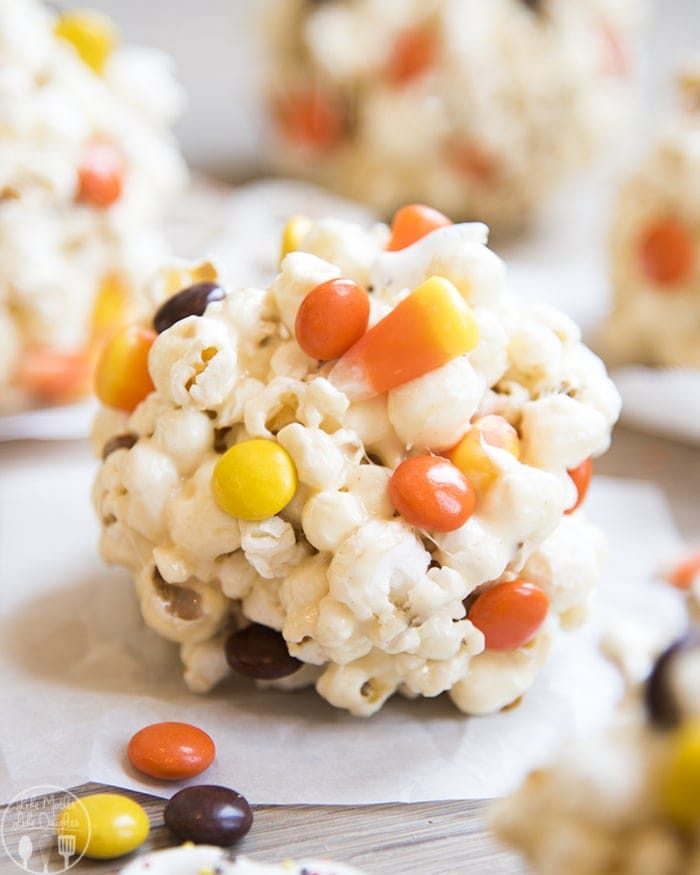Halloween Popcorn Balls are delicious gooey marshmallow popcorn balls stuffed full of your favorite Halloween candies, perfect for a sweet and salty, crunchy treat!