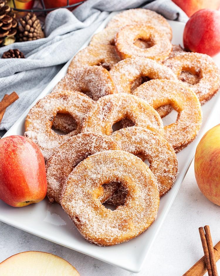 A plate of fried apple rings coated in cinnamon sugar.