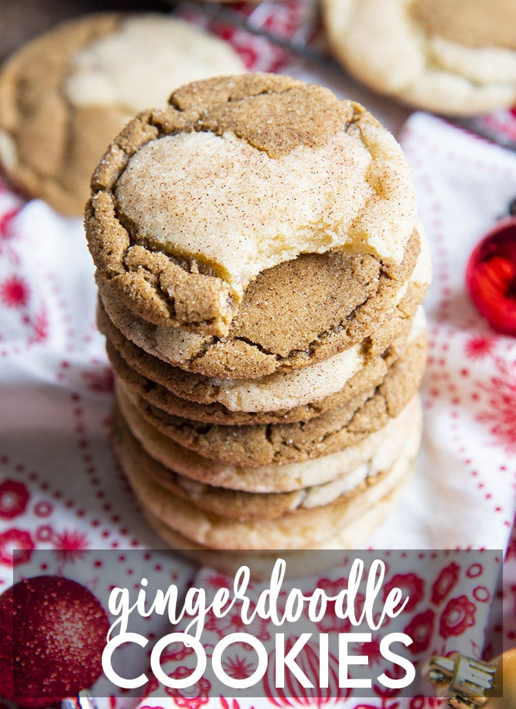A stack of half ginger molasses, half snickerdoodle cookie swirled together. The top has a bite taken out of it. There is a text overlay for pinterest that says Gingerdoodle Cookies.