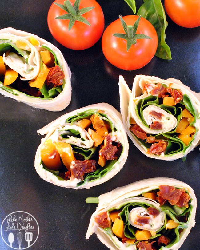 Hummus and Sundried Tomato Roll Ups – these no bake, no cook quick and healthy dinner of hummus sundried tomato rollups - with fresh spinach, fresh basil, and pepper slivers rolled together.