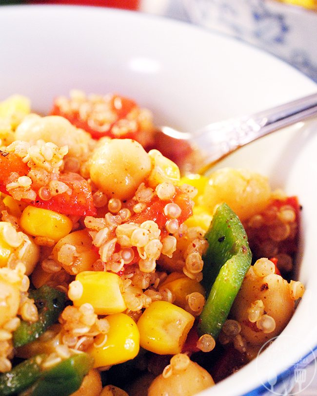 Quina Corn Salad - This salad has a sweet corn taste with flavorful fresh peppers and tomatoes added to protein based quinoa and chickpeas for a salad that can pass as a main dish or side. Serve with fruit and a green salad and you have a delicious meal.