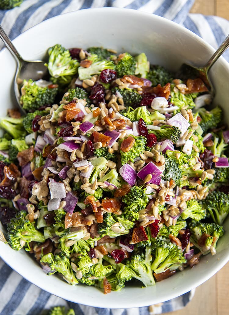 An overhead shot of chopped broccoli salad in a bowl.