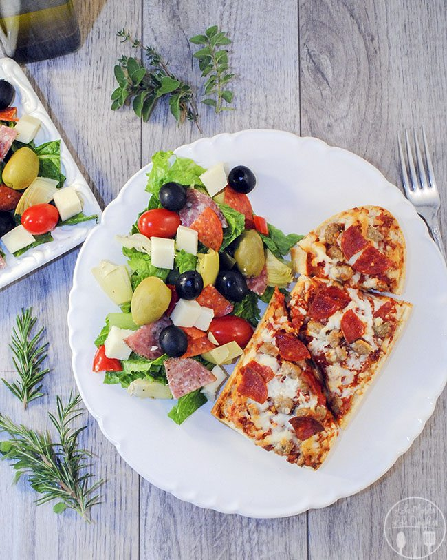 Antipasta salad - This Antipasti Salad is an assortment of olives, salami, pepperoni, cheese, peppers, artichokes, tomatoes, and lettuce all dressed with a homemade Italian vinaigrette