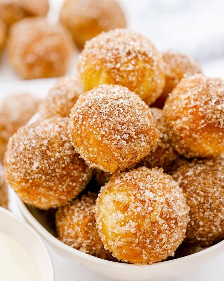 A close up of cinnamon sugar soft pretzel bites.