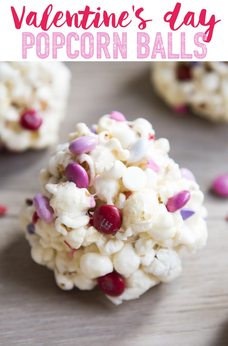 These Valentine's Day Popcorn Balls are delicious marshmallow popcorn balls stuffed full of white chocolate, valentine m&ms, and sprinkles. Such a fun and adorable Valentine's Day treat!