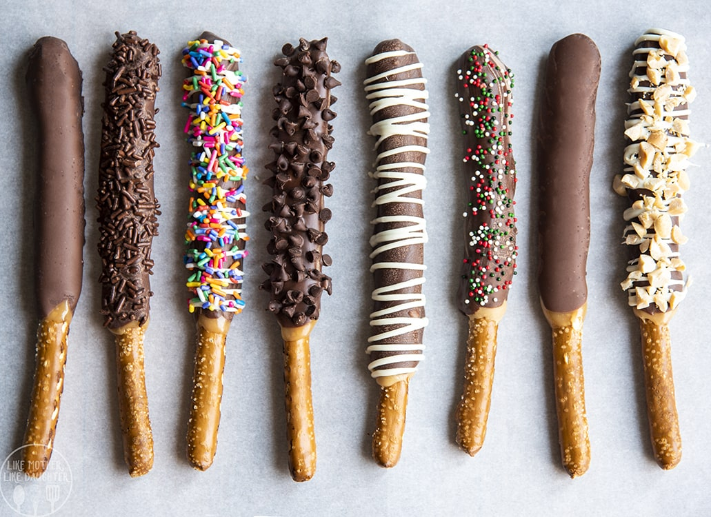 Pretzel Rods coated in caramel and chocolate and sprinkles.