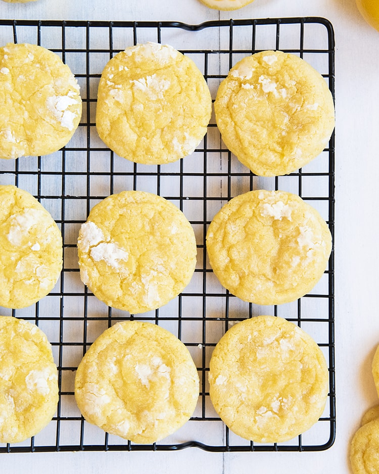 Lemon Crinkle Cookies coated in powdered sugar for a perfect tray of sunshine