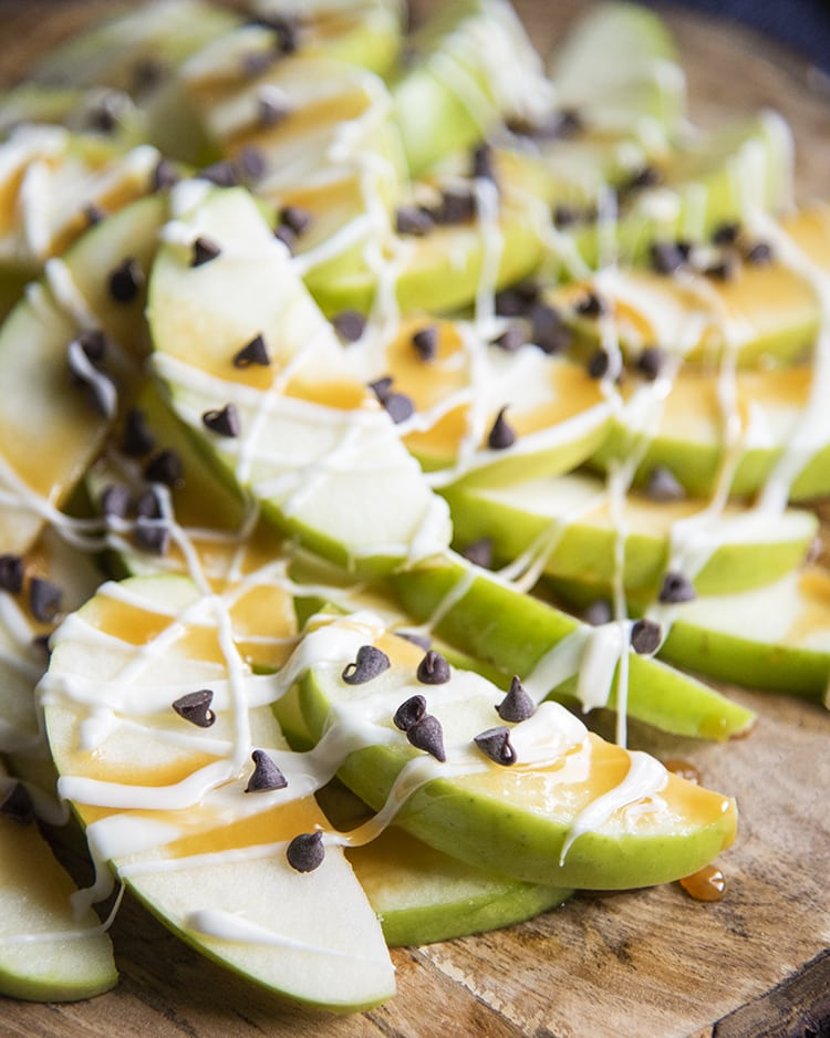 Apple nachos are a perfect healthier treat, with sliced apples topped with caramel sauce, drizzled white chocolate, chocolate chips and any other delicious toppings you like!
