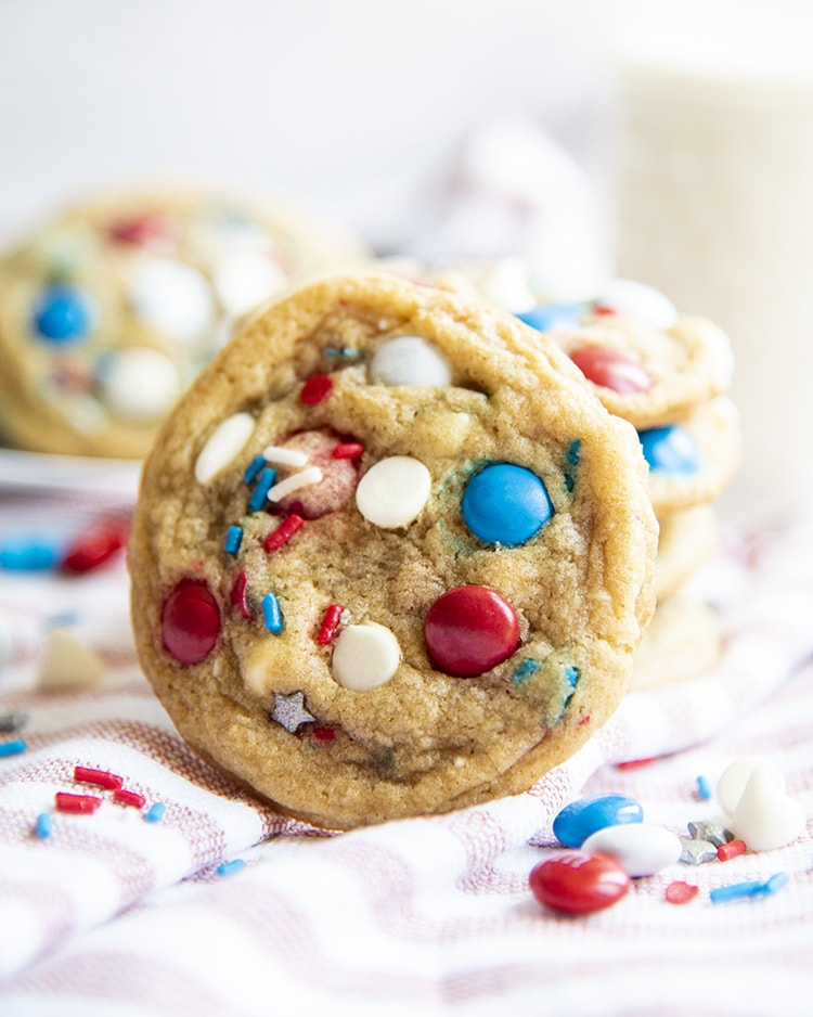 Cookies filled with white chocolate chips, red, white and blue m&ms and sprinkles