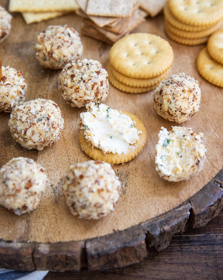 A cheese ball spread on a round cracker.