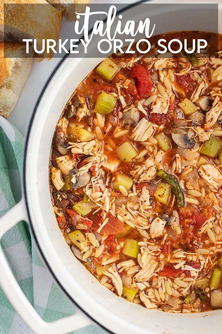 A pot of Italian Turkey Orzo Soup loaded with lots of vegetables with a text overlay saying Italian Turkey Orzo Soup.
