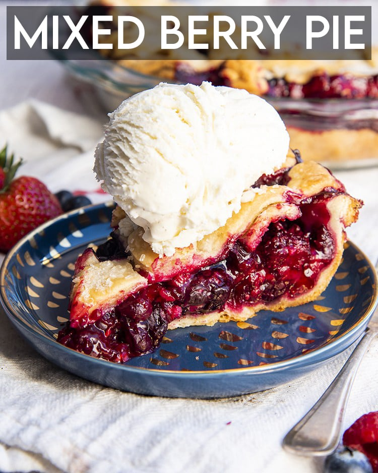 A slice of mixed berry pie on a blue plate showing all the juicy red berries in the middle with a lattice pie crust on top, with a scoop of vanilla ice cream on top. The photo has a text overlay over the top for pinterest.