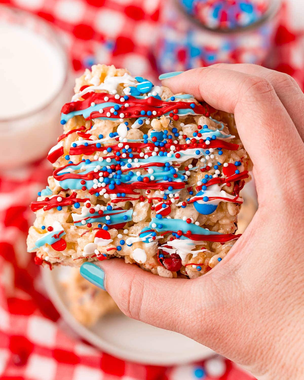A hand holding a 4th of July Rice Krispie Treat