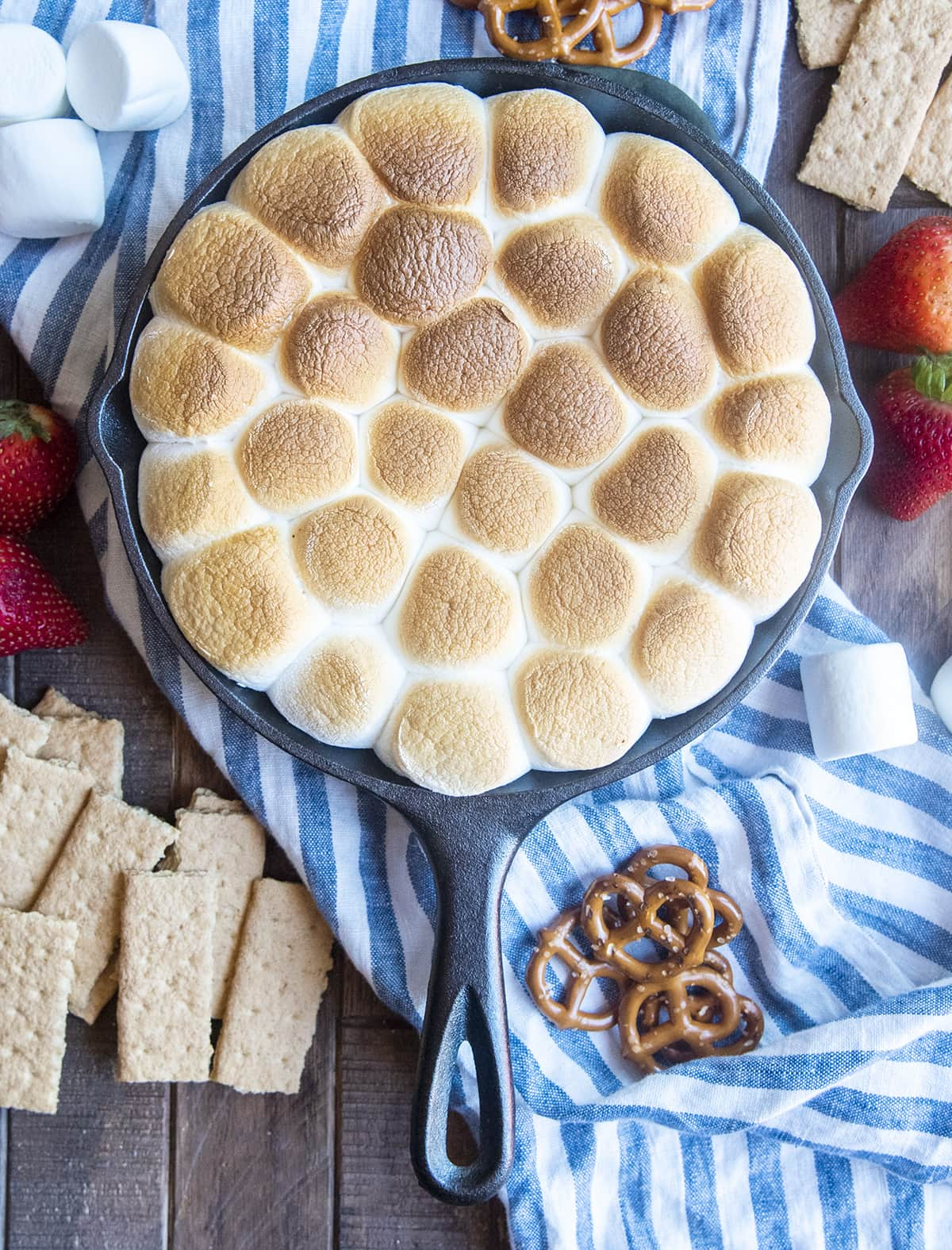 A cast iron pan full of toasted marshmallows.