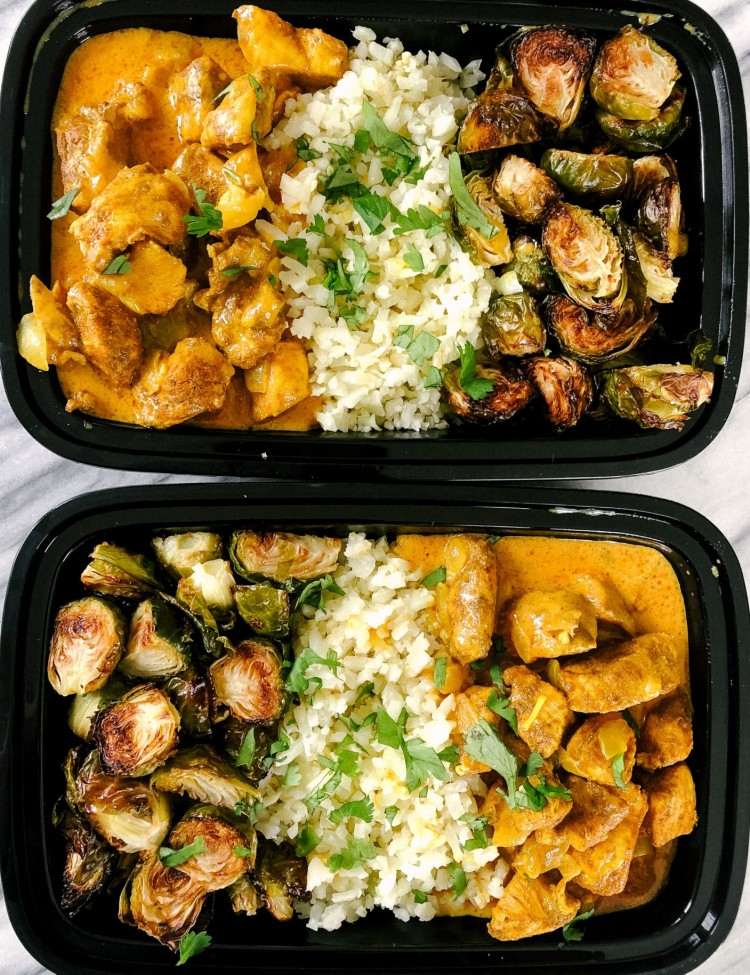 Above view of butter chicken in meal prep containers