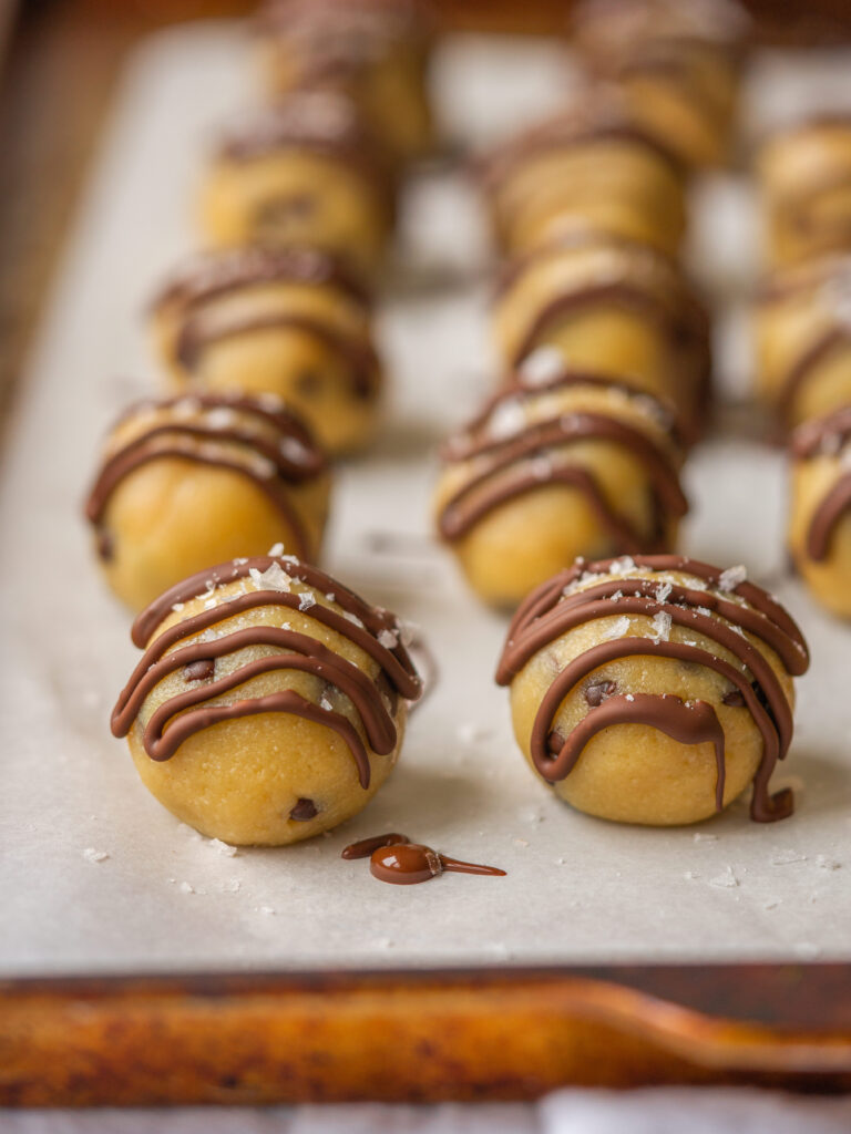 three quarter view of  5 ingredient cookie dough bites with chocolate drizzle