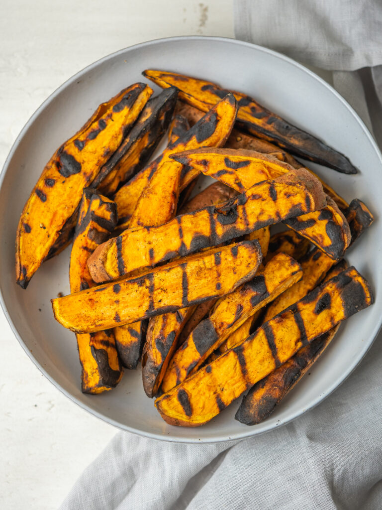 Above view of BBQ sweet potato wedges on a serving plate