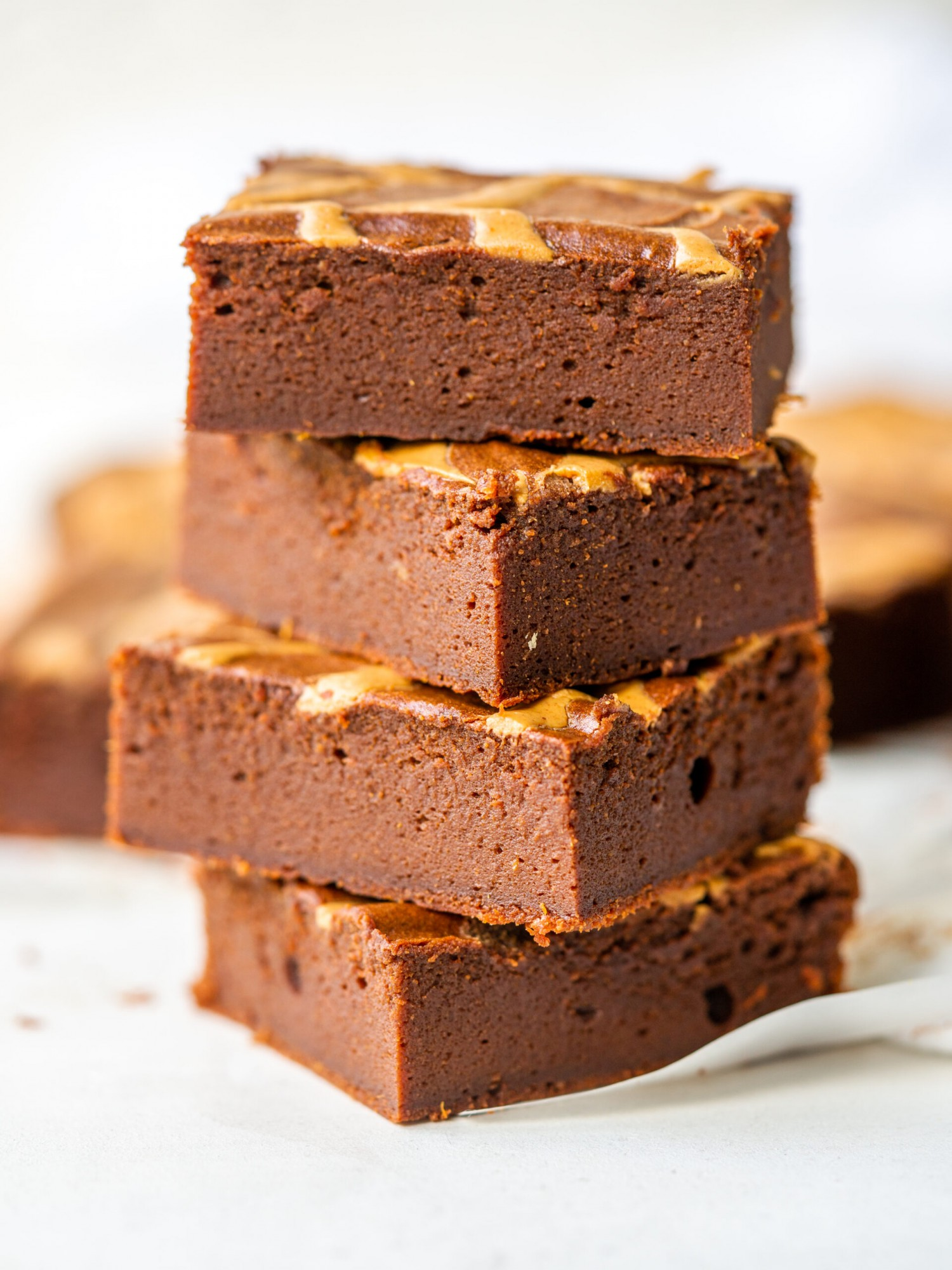 Side view of a stack of Flourless Sweet Potato Brownies