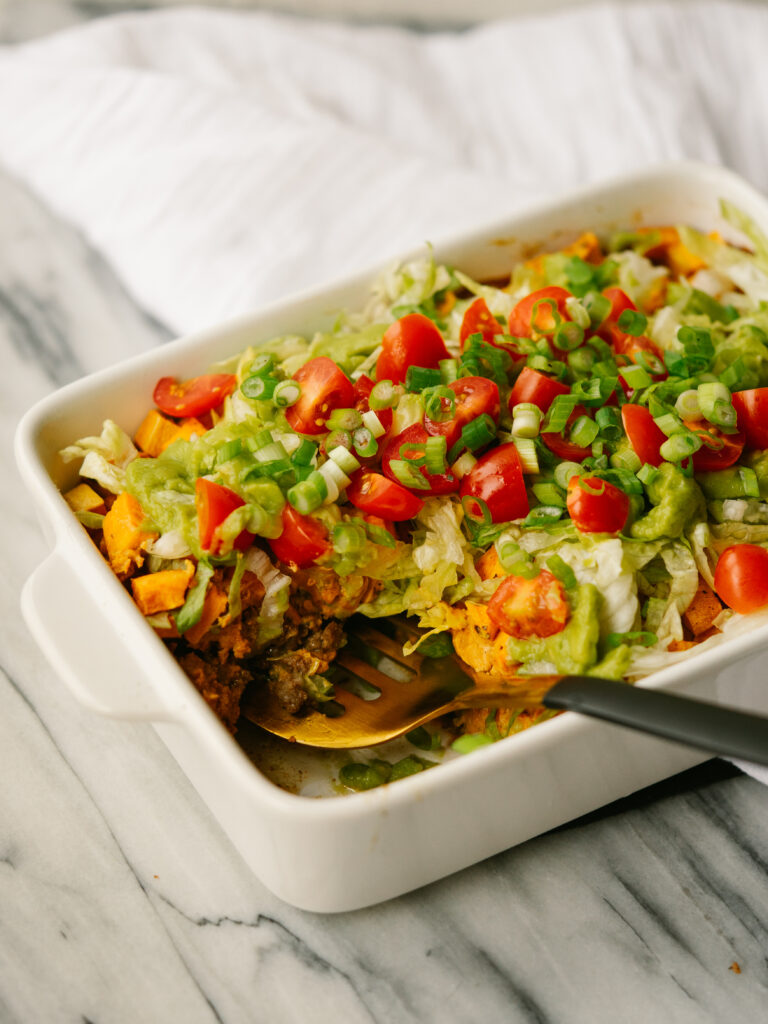 taco casserole with a slice cut out