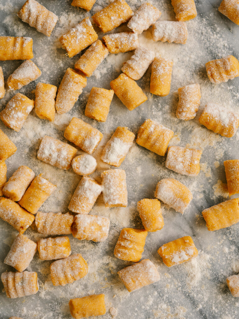 overhead view of uncooked sweet potato gnocchi rolled out and cut