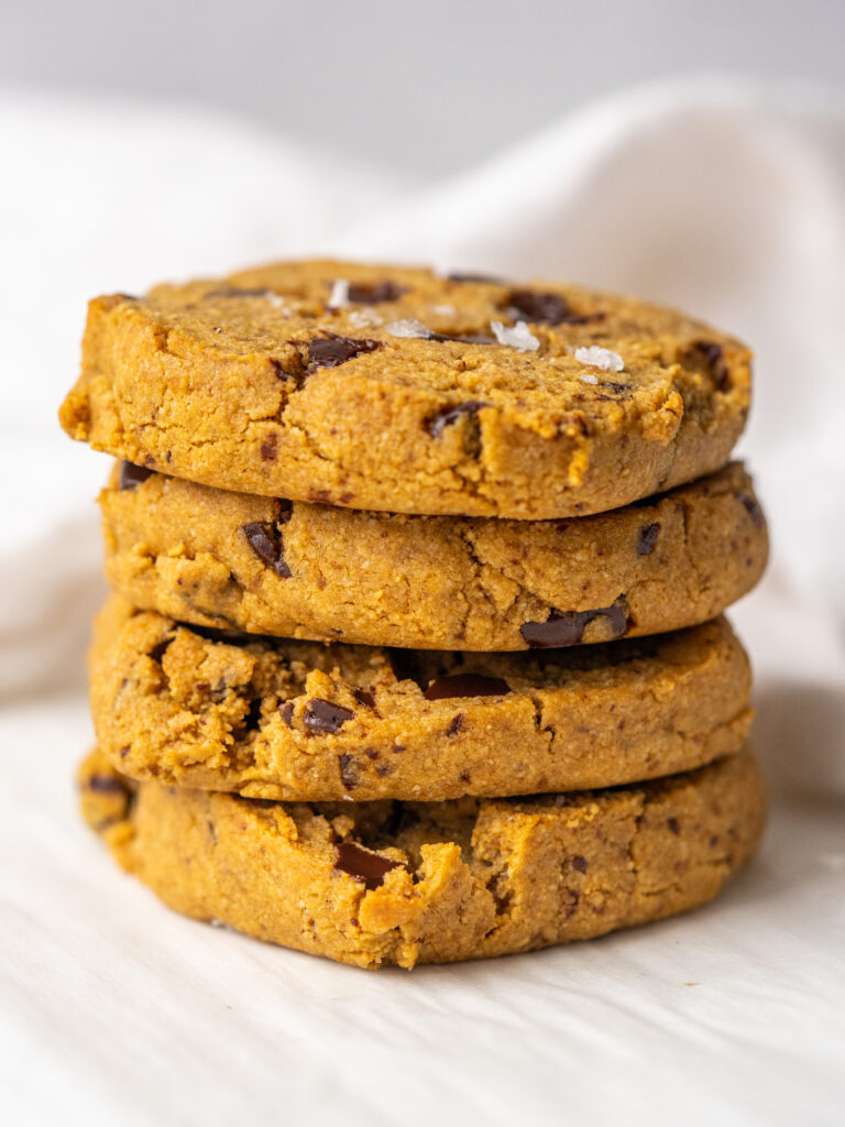 Side view of a stack of chocolate chip paleo cookies