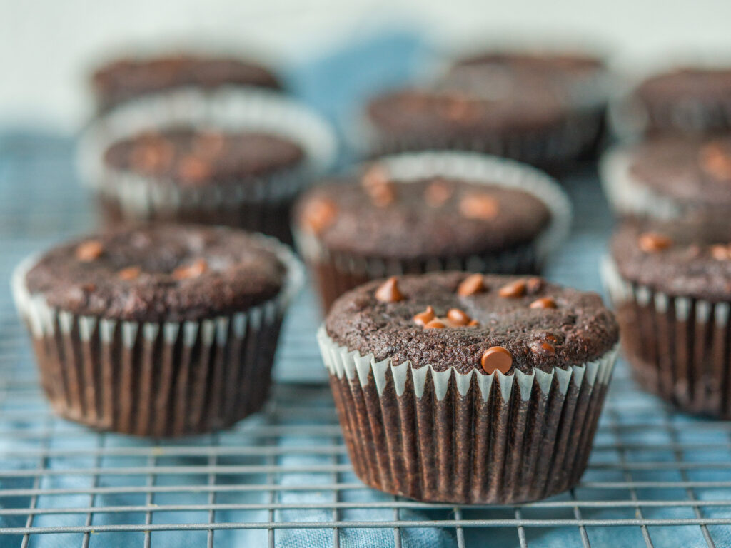 three quarter view of healthy double chocolate muffins on a cooling rack