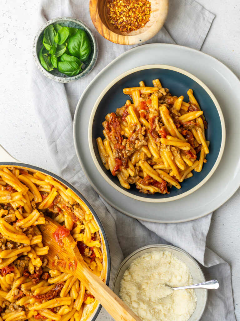 Above with of a bowl of sun dried tomato and turkey one pot pasta