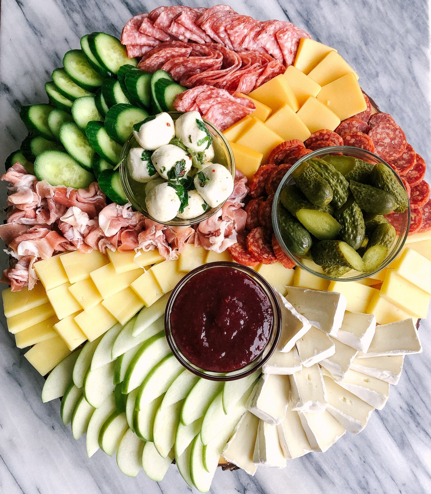 Above view of a colorful charcuterie board for a party