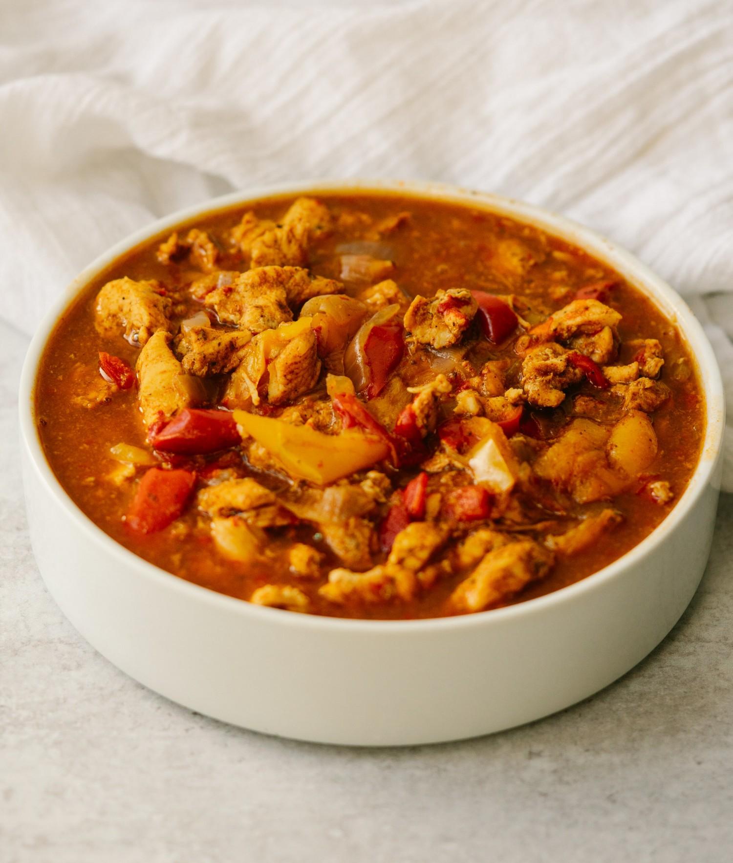 Three quarter view of Instant Pot Chicken Fajitas in a serving bowl