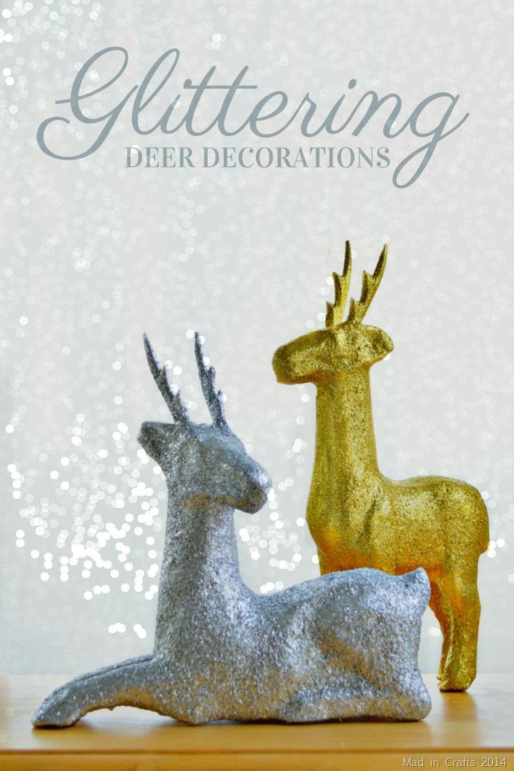 DIY glitter paper macher deer in front of a bokeh background