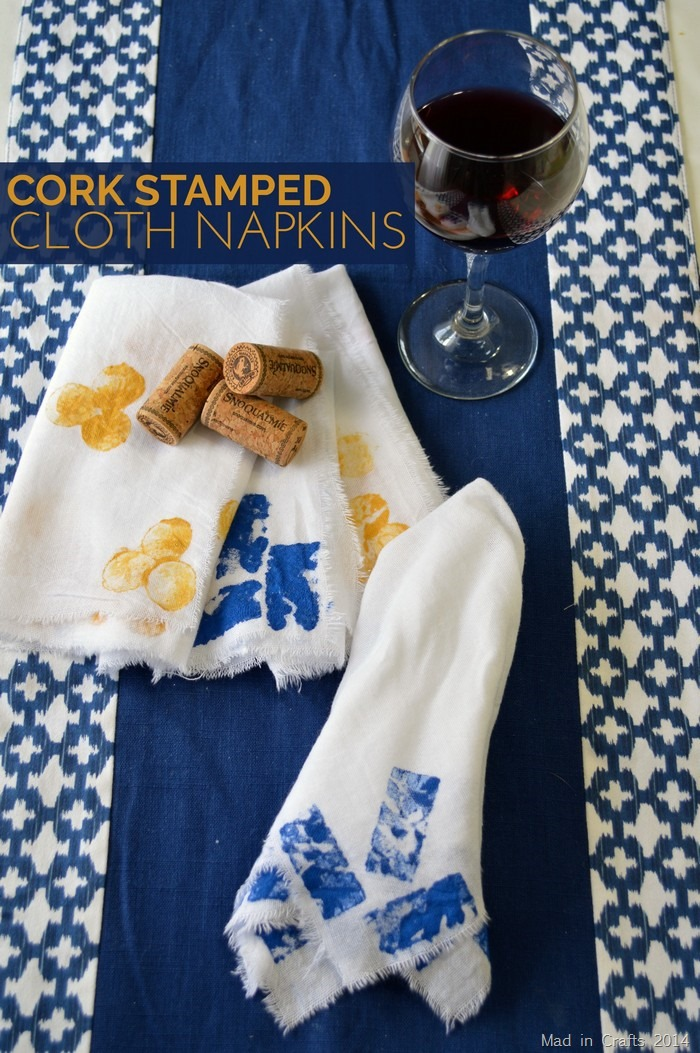 stamped cloth napkins, wine corks, and a blue background