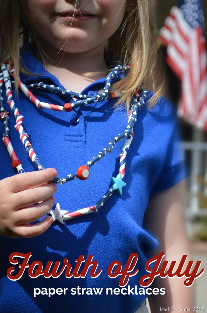 girl in blue shirt wearing necklaces made of paper straws