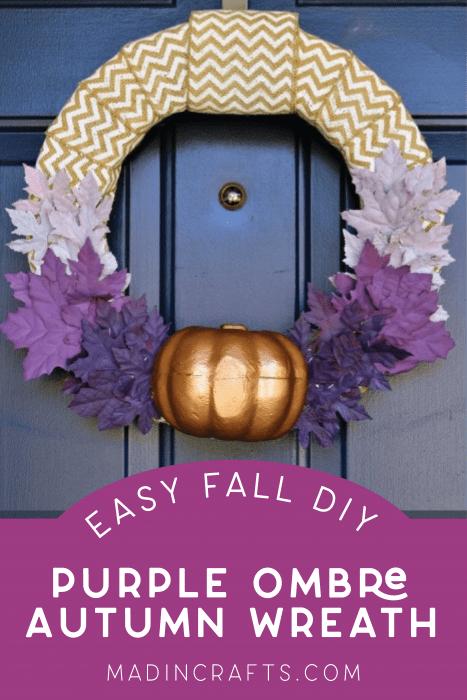 fall wreath with purple leaves and a pumpkin on a blue door