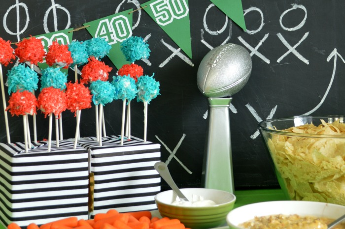 Super bowl party table with food and Lombardi Trophy centerpiece