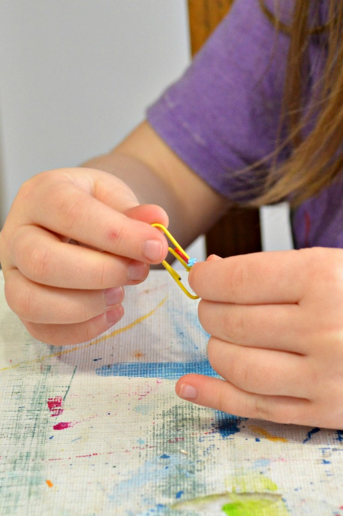 Link paper clips together to make a chain