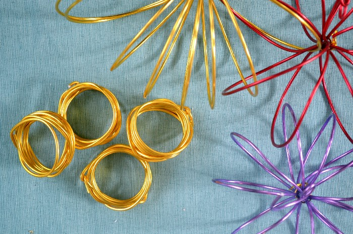 colorful wire Napkin rings  on a blue background