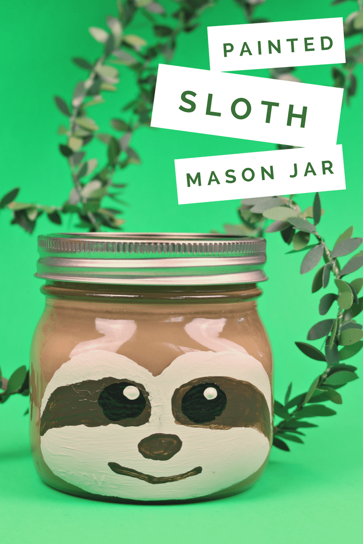 painted sloth mason jar on a green background with vines