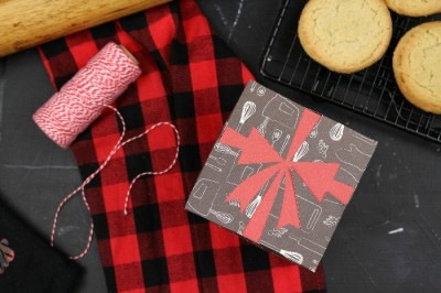 Cricut cut paper gift box with plaid towel and baker's twine