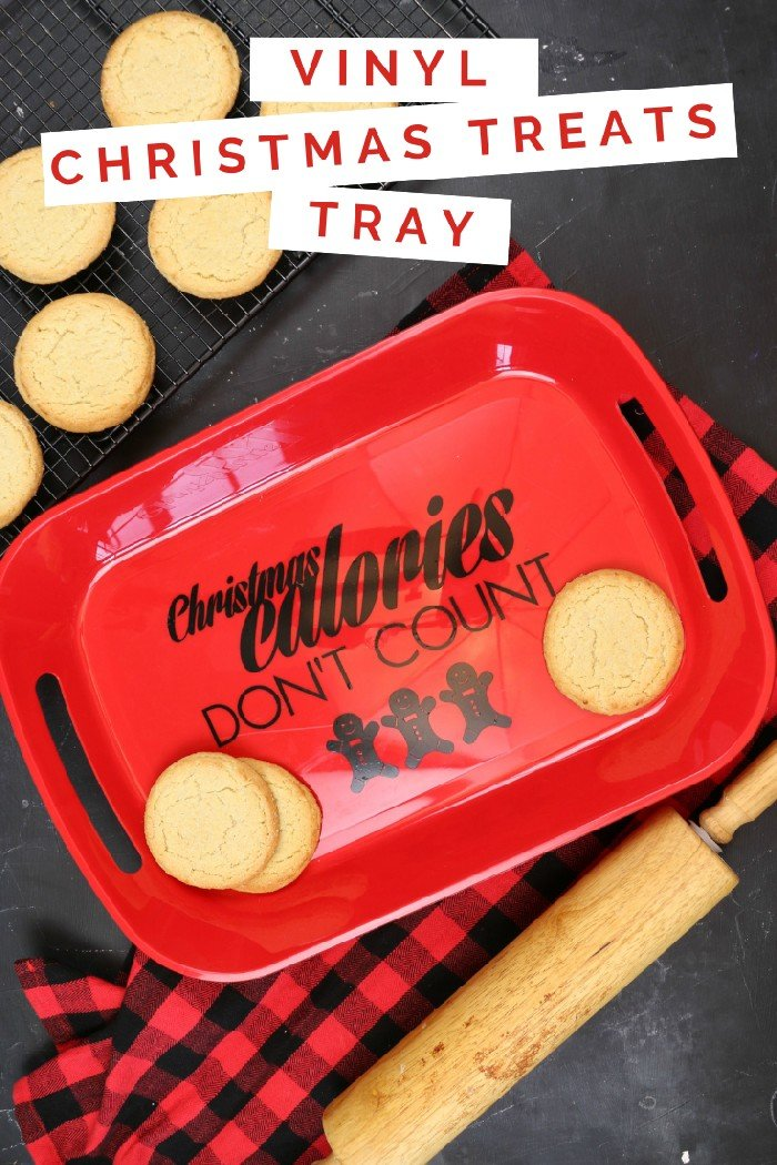 cookies, rolling pin, and red tray with vinyl reading Christmas Calories Don\'t Count