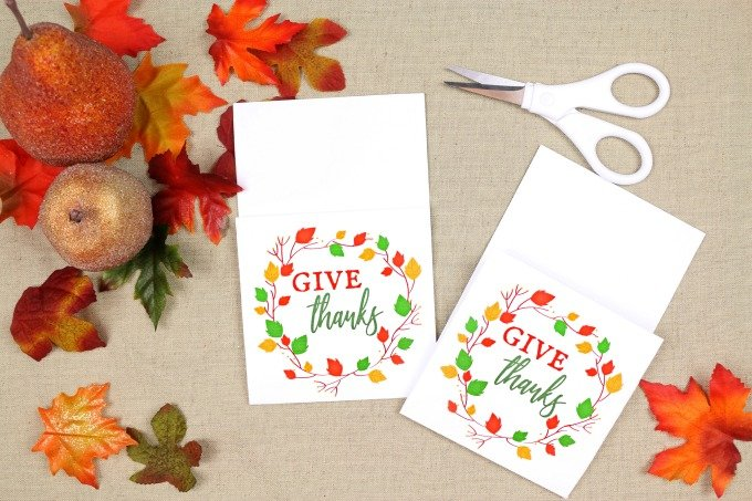 printable utensil holder on a table with fall leaves and scissors