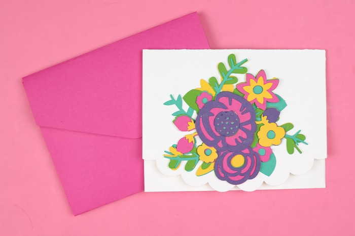 Cricut cut layered flowers on a card with a pink envelope