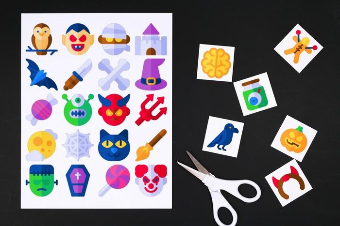 printable halloween bingo cards, tiles, and scissors on a black background