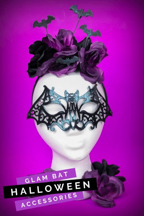 Halloween bat mask and purple flower headband on a foam head with a purple background