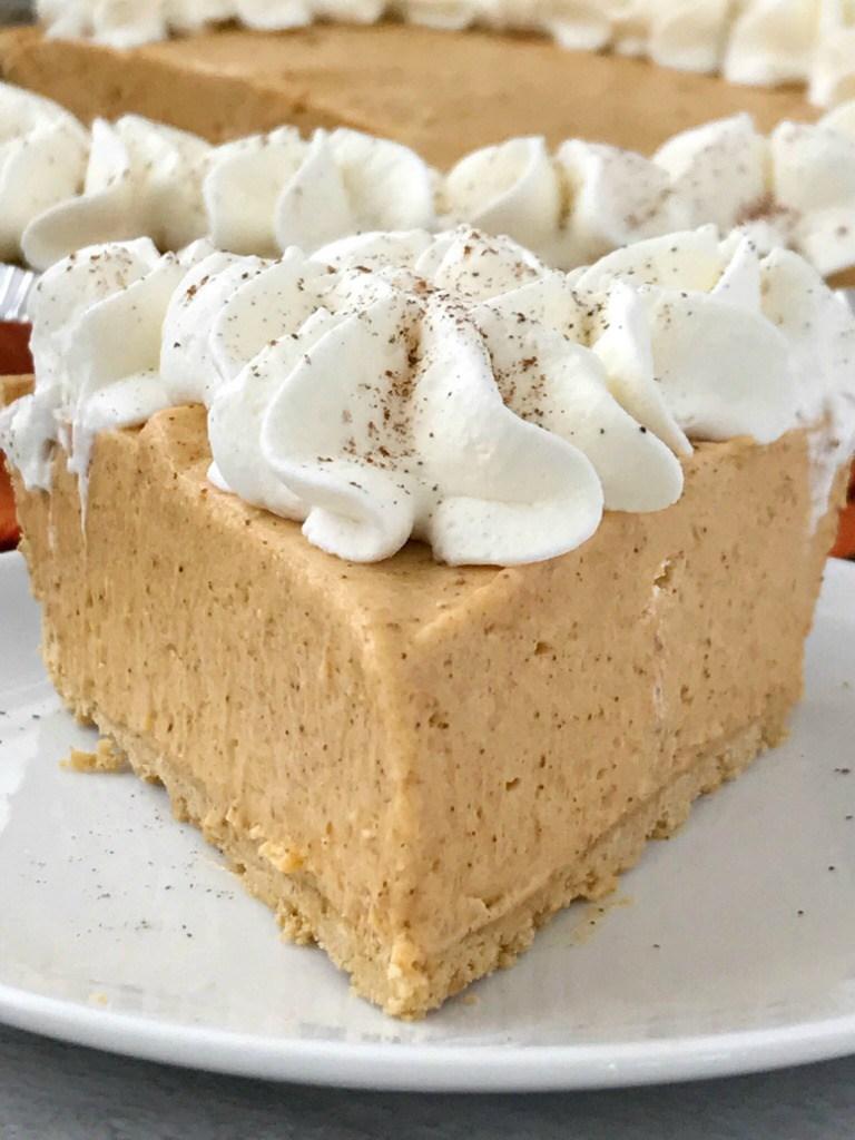 pumpkin cream pie on a plate