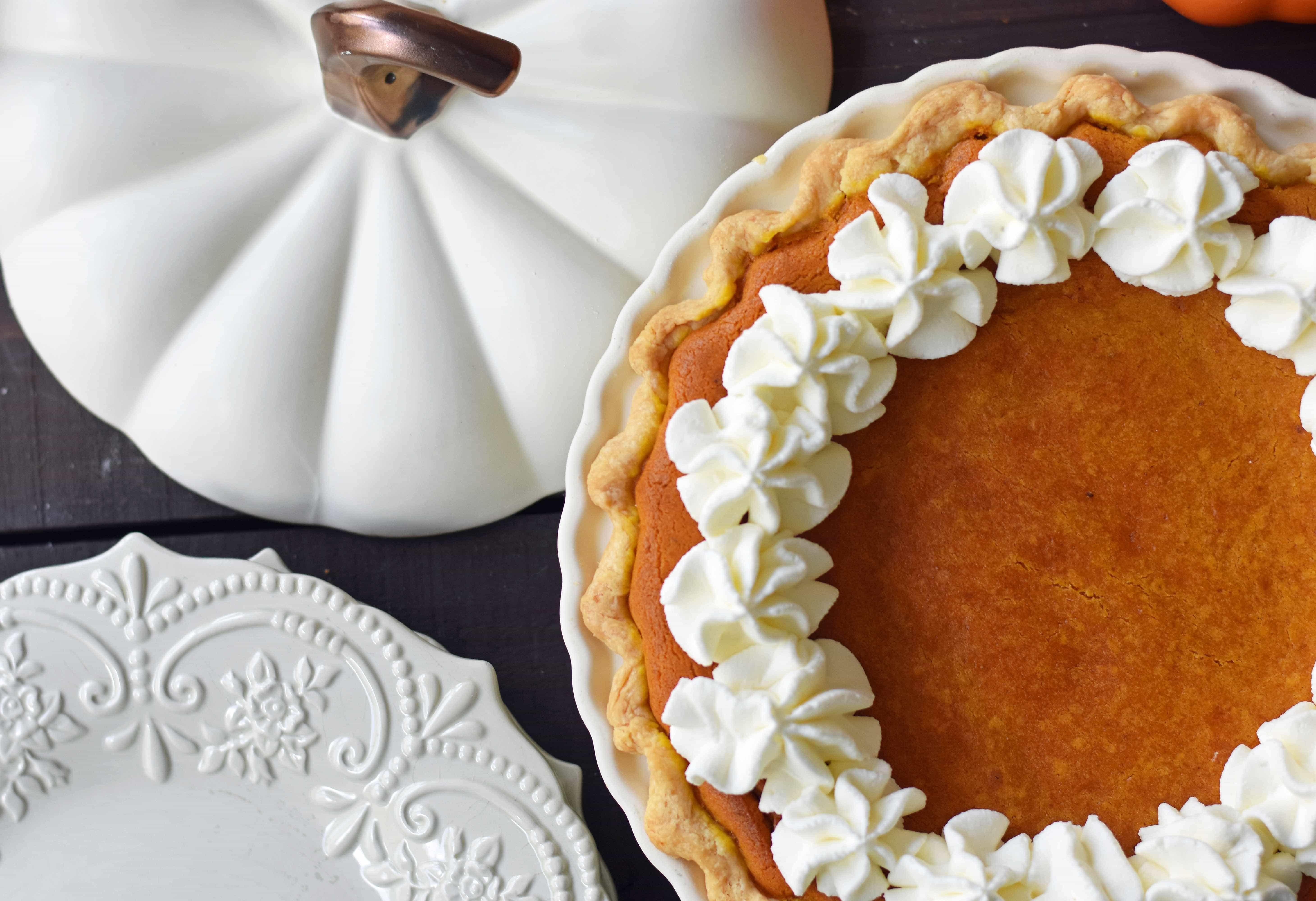 pumpkin pie next to a white pumpkin